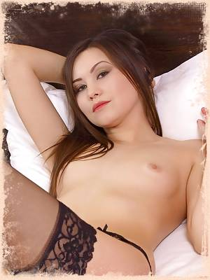 Kristina teases her way out of her black lingerie on her silk bed.