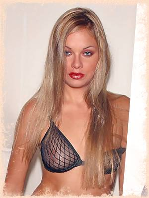 Phoenix teasing in her black, fishnet lingerie sits on the toilet peeing showing her wet pussy