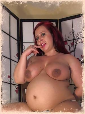 Pregnant horny pornstar Georgia Peach shows off her big belly as she strips out of her cupcake lingerie