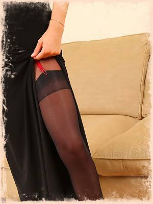 Rosie looks great bursting out of her dress in black layered nylons