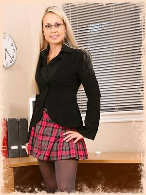Renata in a black jacket sexy miniskirt and grey pantyhose.