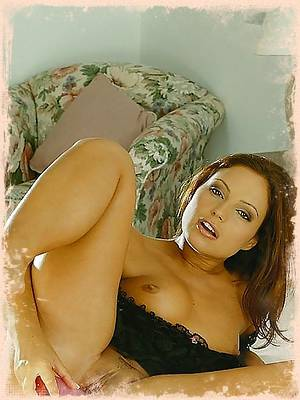 Luscious women in lingerie pleases herself by using a dildo