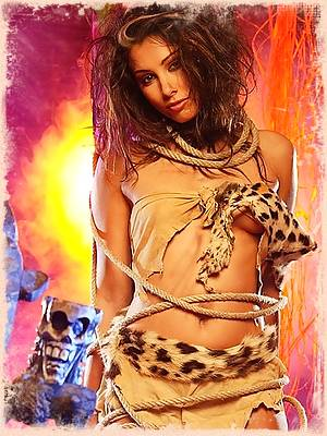 Pornstar Anetta Keys showing her hot body in a cave girl outfit