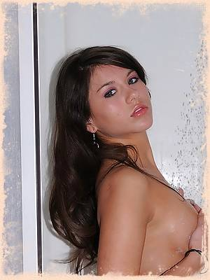 A very naked Shyla gets wet and soapy in the shower