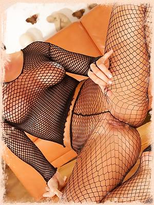 Silvia Saint exposes her stunning body in black fishnet lingerie