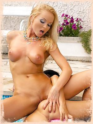 Silvia Saint is sharing a big dildo with her girl-friend and she is loving it
