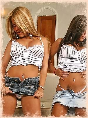 The twins strip off their matching denim skirts