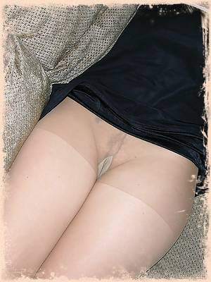Blonde MILF With Hairy Pussy Underneath Pantyhose
